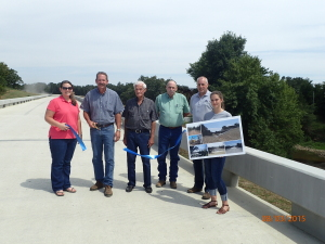 On August 3, 2015, LeFlore County District #2 dedicated the newly constructed Bridge #171 over Brazil Creek. The original historic truss bridge stayed in place and can viewed from the new 403 feet long precast concrete beam bridge.