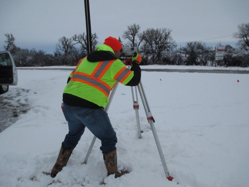 GUY Engineering surveyor in the snow